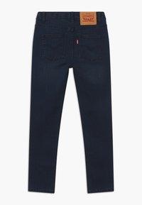Levi's® - SKINNY TAPER - Skinny džíny - dark-blue denim - 1