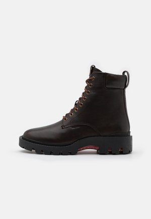 CITYSOLE DISTRESSED BOOT - Lace-up ankle boots - walnut