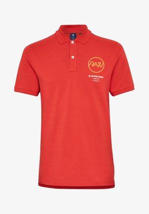 GS RAW GRAPHIC SLIM - Polo shirt - dark candy