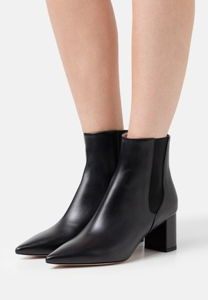 INES - Classic ankle boots - black