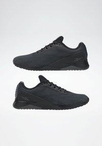 Reebok - NANO X1 GRIT SHOES - Neutral running shoes - black - 5