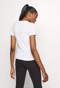 Champion - CREWNECK LEGACY - Print T-shirt - off-white - 2