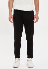 DeFacto Fit - Tracksuit bottoms - black - 0