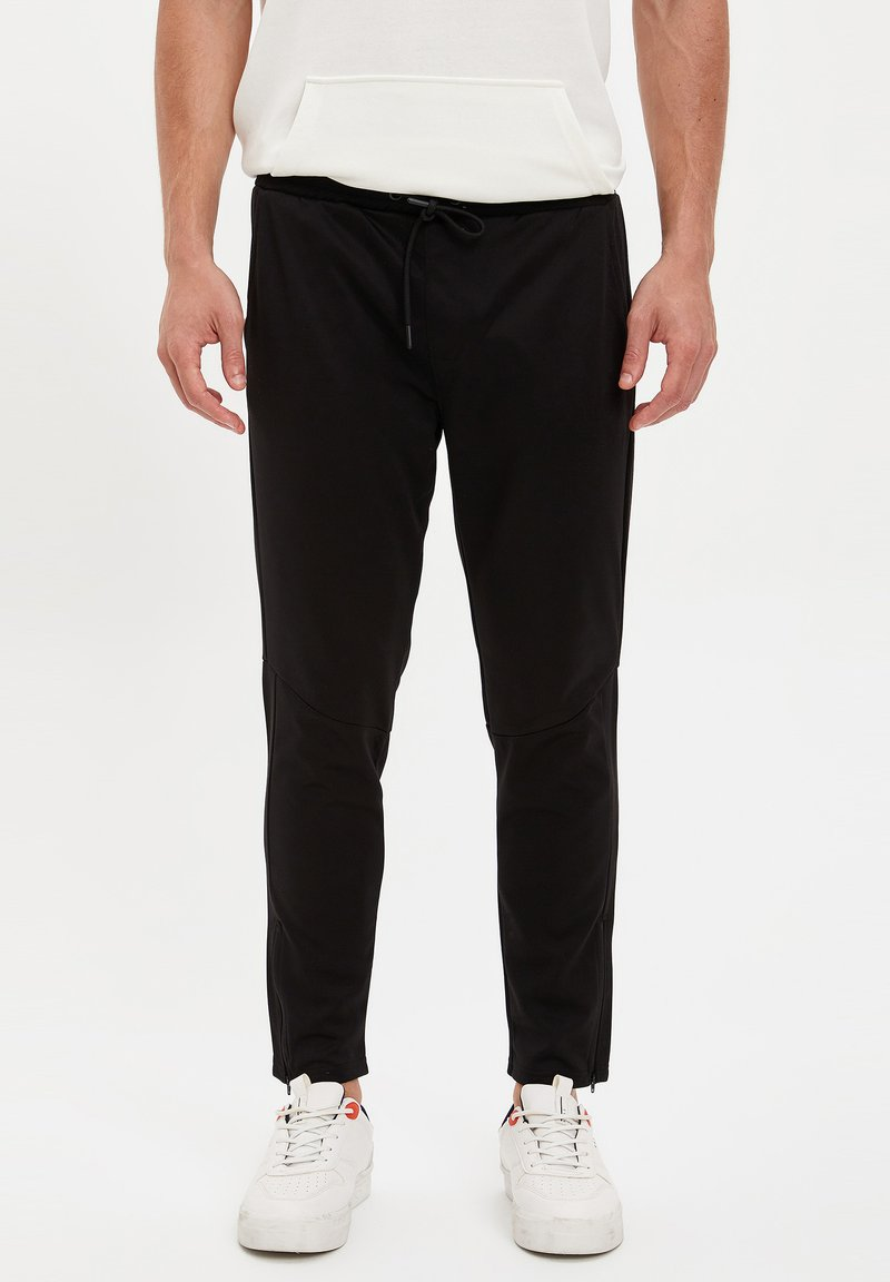 DeFacto Fit - Tracksuit bottoms - black