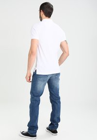 Tommy Jeans - ORIGINAL FINE SLIM FIT - Polo shirt - classic white - 2