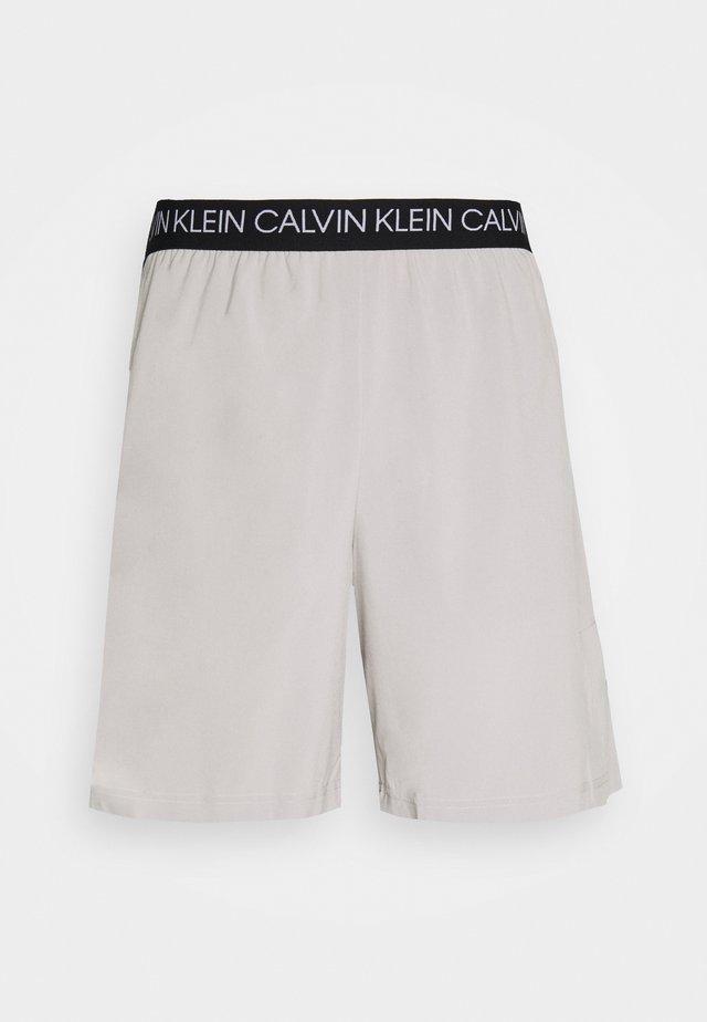 SHORTS - Sports shorts - beige
