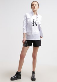 Calvin Klein Jeans - Print T-shirt - bright white - 1