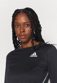adidas Performance - REFLECTIVE - Camiseta de deporte - black - 3