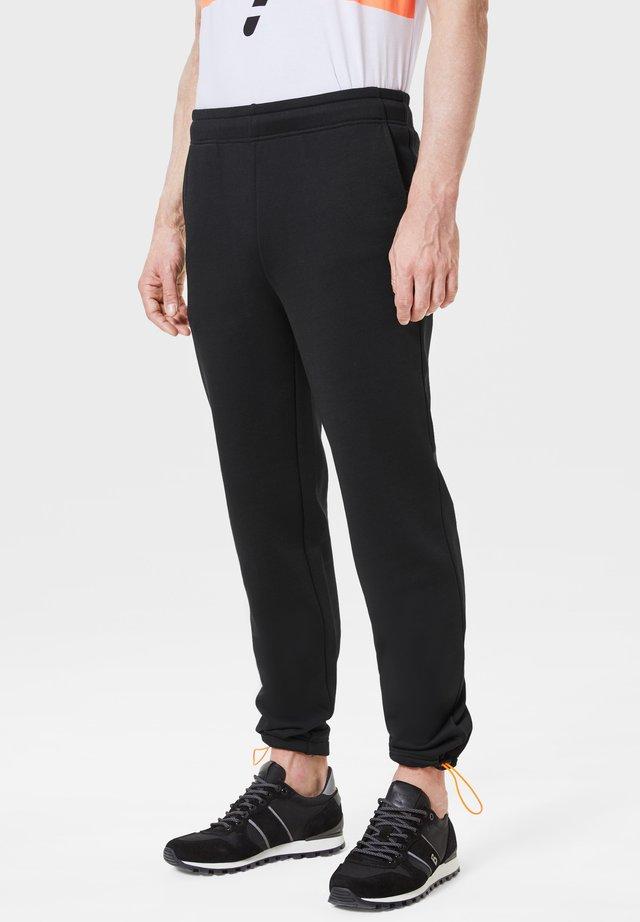 RUSH - Pantalon de survêtement - schwarz