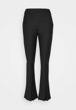 TROUSERS - Trousers - nero