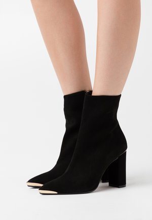 CAMELIE - High heeled ankle boots - nero
