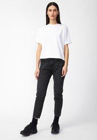 ARMEDANGELS - CAJAA - Slim fit jeans - black - 1