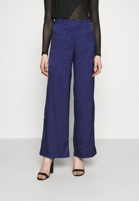 Never Fully Dressed - VOGUE - Trousers - blue - 0