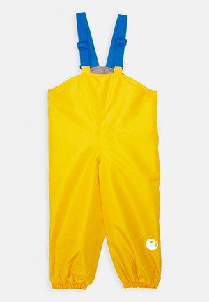 PULLEA UNISEX - Kalhoty do deště - yellow