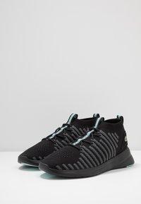 Lacoste - FIT FLEX - Sneakersy niskie - black/light green - 2
