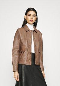 Sisley - Leather jacket - brown - 0