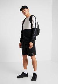 Reebok - TRAINING SHORTS - Sports shorts - black - 1
