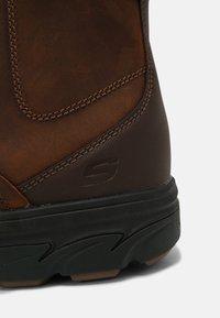Skechers - RESMENT KORVER - Classic ankle boots - dark brown - 4