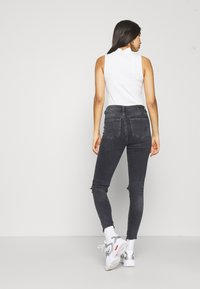 American Eagle - HIGHEST RISE JEGGING - Jeggings - black in the dayz - 0