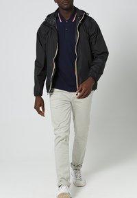 K-Way - LE VRAI CLAUDE UNISEX - Waterproof jacket - black - 0