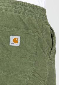 Carhartt WIP - Shorts - mottled dark green - 3