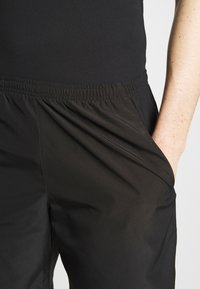 Nike Performance - RUN SHORT - Pantalón corto de deporte - black - 3