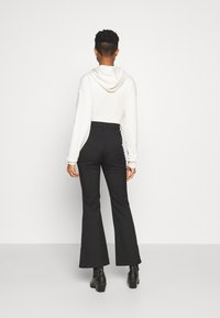 Monki - RAMONA TROUSERS - Flared Jeans - black - 2