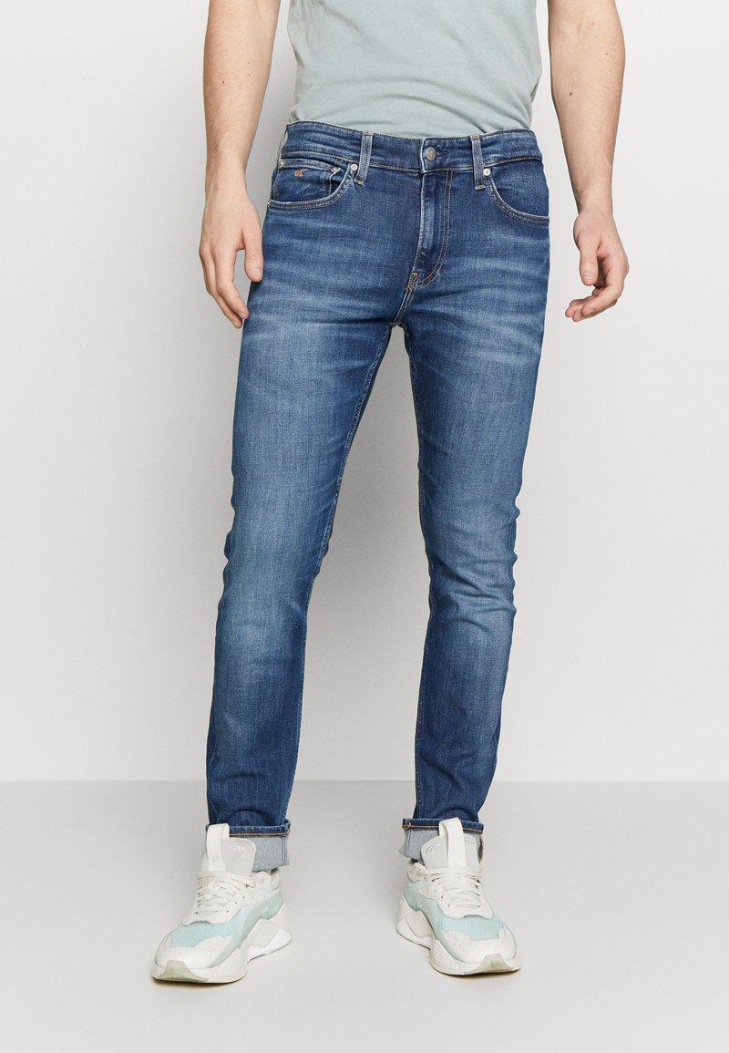Calvin Klein Jeans - SLIM - Slim fit jeans - mid blue