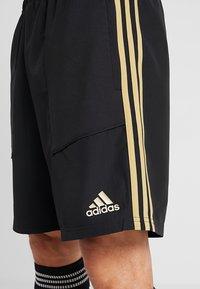adidas Performance - REAL MADRID - Sports shorts - black/dark gold - 3