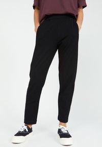 ARMEDANGELS - MAGDAA MAGDAA - Trousers - black - 0