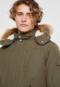 Calvin Klein Jeans - FUR TRIMMED HOODED DOWN BOMBER - Down jacket - dark green - 5
