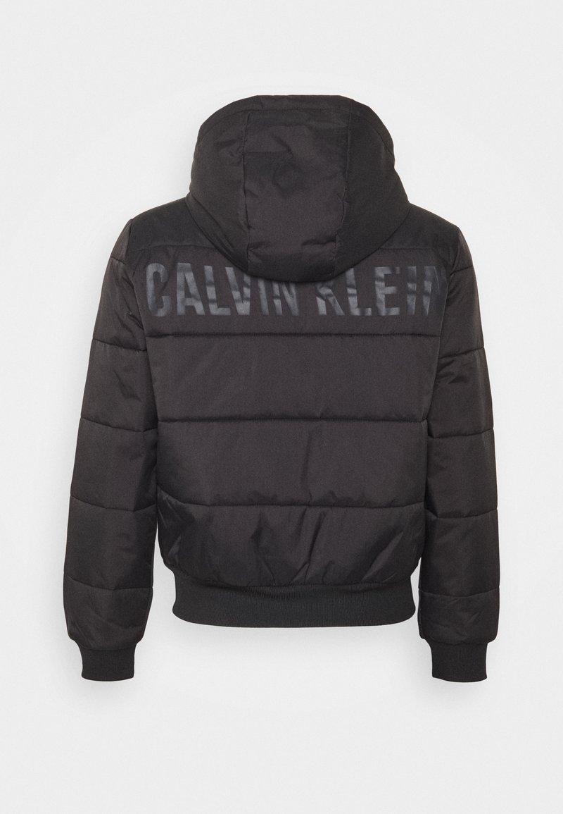 Calvin Klein Performance - PADDED - Training jacket - black