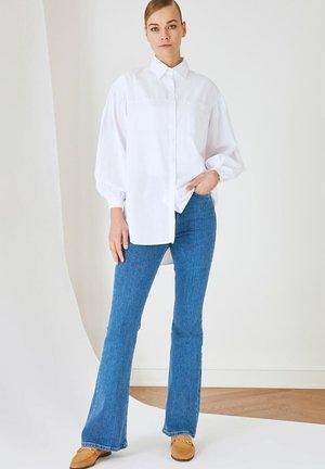 PARENT - Flared Jeans - navy blue