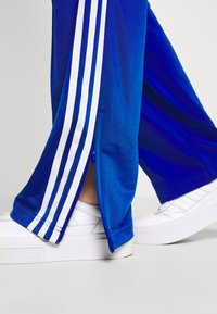 adidas Originals - FIREBIRD - Pantalones deportivos - team royal blue