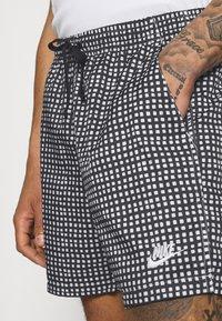 Nike Sportswear - FLOW GRID - Shorts - black/white - 3