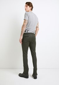 Replay - Trousers - black - 2