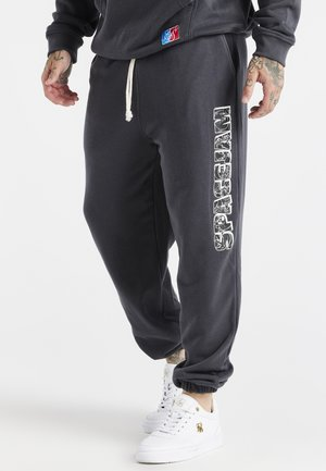 SPACE JAM RELAXED FIT JOGGER - Tracksuit bottoms - dark grey