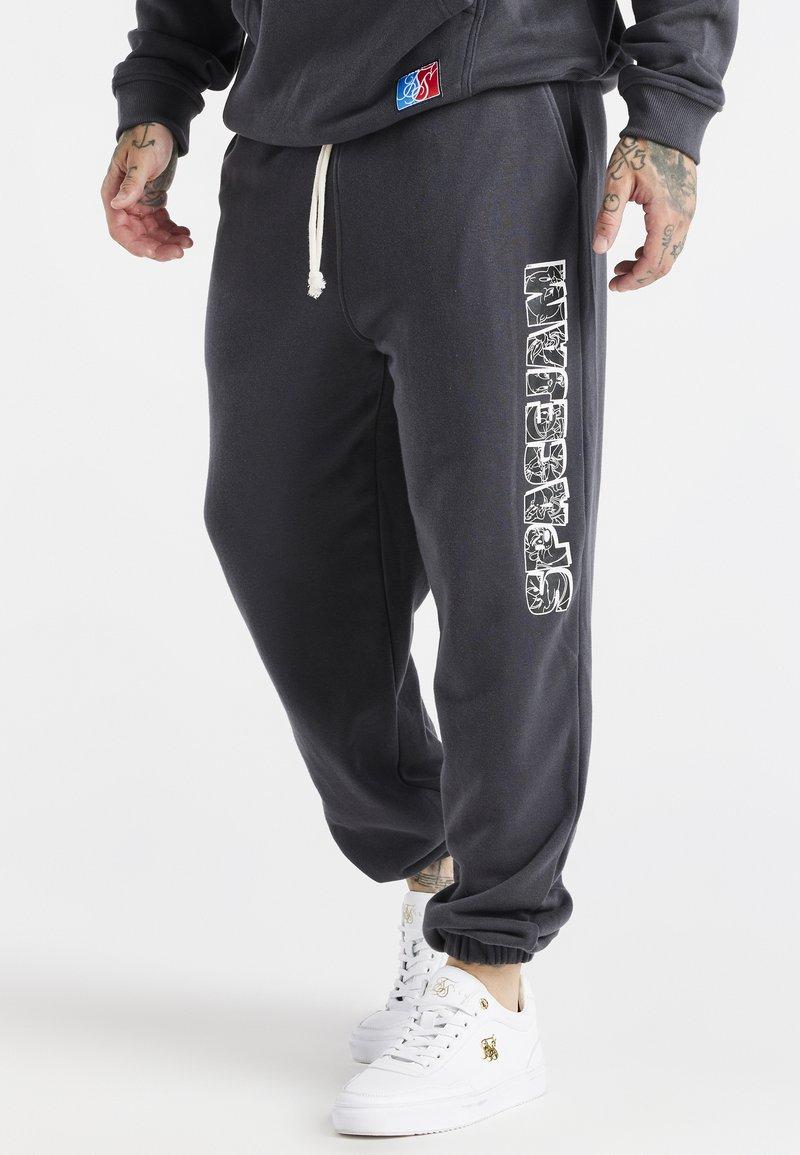 SIKSILK - SPACE JAM RELAXED FIT JOGGER - Pantalon de survêtement - dark grey
