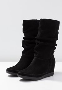 Shoe The Bear - EMMY SLOUCHY - Wedge boots - black - 4