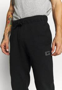 Diesel - UMLB-PETER  - Tracksuit bottoms - black - 5