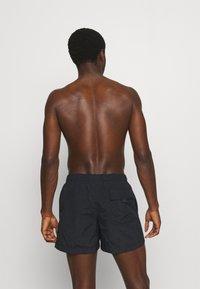 Champion - Swimming shorts - black - 0