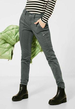 MIT NIETEN - Trousers - grün