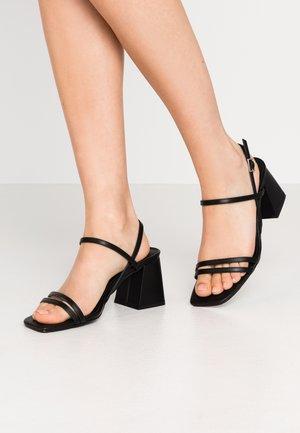 ZOONA - Sandaalit nilkkaremmillä - black