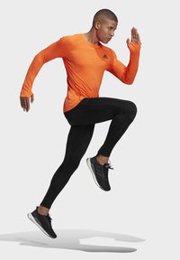 adidas Performance - RUNNER LONG-SLEEVE TOP - Long sleeved top - orange - 1