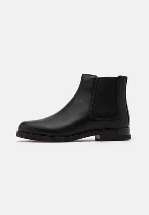 IMAN - Kotníková obuv - black