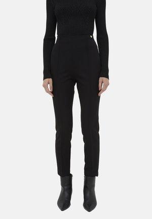 SKINNY BISTRETCH - Trousers - nero