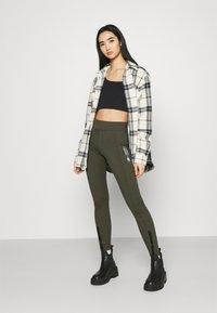 Nike Sportswear - LEGASEE ZIP - Legging - cargo khaki/white - 1