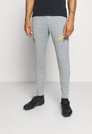 DRY STRIKE PANT - Pantalon de survêtement - smoke grey/heather/smoke grey/total orange