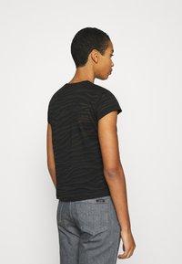Calvin Klein Jeans - BURN OUT ZEBRA LOGO - Print T-shirt - black - 2