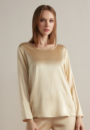 Long sleeved top - crema
